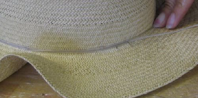 Tie blocked crown of hat with string