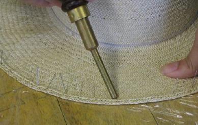 Pinning brim edge using a pin pusher for blocking in one